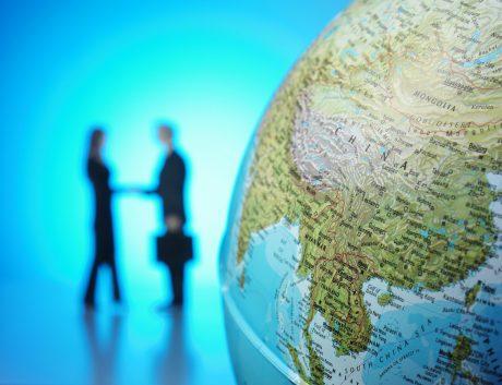 Business agreement globe China SE Asia