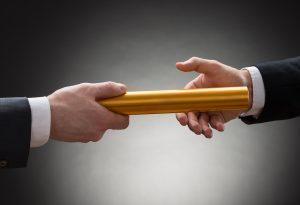 Hands-Gold-Relay-Baton-Business_News