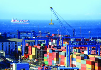 Shipping port containers cargoship in Chile_extended sky_repositioned ship
