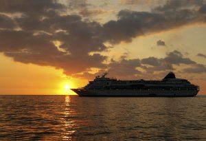 Passenger ship sunset sea