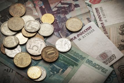 Russian money dark background. Rubles banknotes and coins