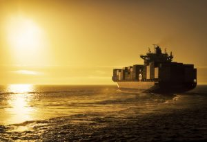 Cargo container ship sunset