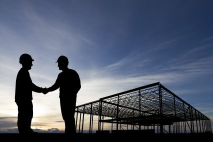 Construction site building handshake