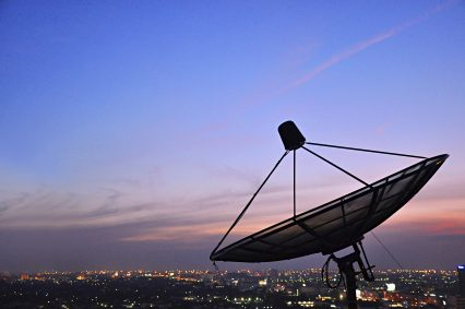 A satellite dish in twilight scene