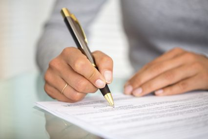 Signing contract pen hand