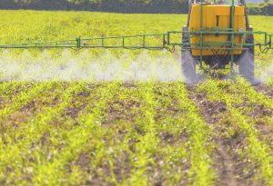 Agribusiness Spreading herbicide