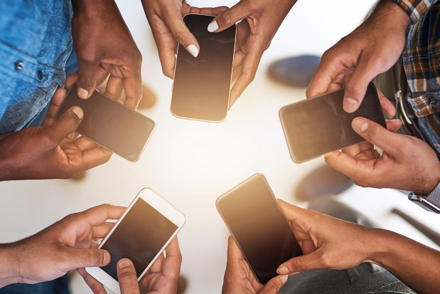 People-Holding-Smart-Phones-Connection_News
